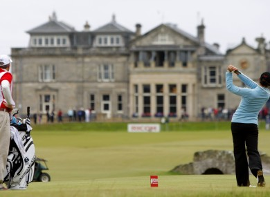 File photo of tournament winner and world number one Mexico's Lorena Ochoa as she tees off from the 18th with the St Andrews clubhouse.