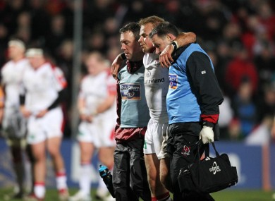 Luke Marshall is helped off the Ravenhill pitch by Ulster medics.