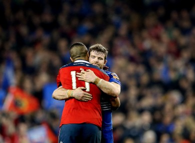 Munster's Simon Zebo embraces Gordon D'Arcy at the final whistle.