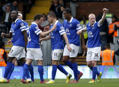 Everton's Steven Naismith (right) celebrates after scoring his side's third goal.