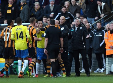 Newcastle United's manager Alan Pardew gestures after confronting Hull City's David Meyler.