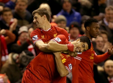 Liverpool's Steven Gerrard (left) celebrates with team-mate Luis Suarez after scoring his side's first goal of the game.