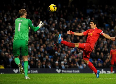 Joe Hart collects the ball under pressure from Luis Suarez.