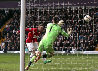 Manchester United's Wayne Rooney (left) scores his team's second goal.