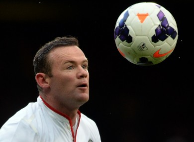 Manchester United's Wayne Rooney eyes the ball before scoring.
