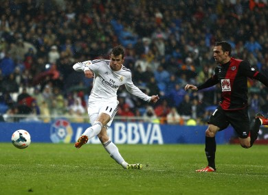 Gareth Bale strokes home his second goal.