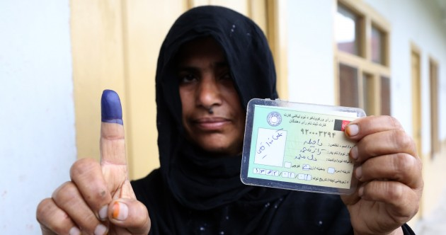 Afghan voters brave Taliban threats in historic election