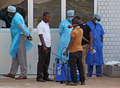 Medical staff at the emergency entrance of a hospital receive suspected Ebola patients in Guinea earlier today.