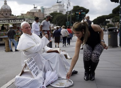 Plisko Julius, from Slovakia, impersonating late Pope John Paul II this week as tourists flocked to the Vatican.