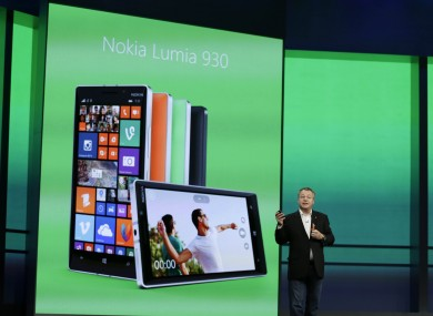 Executive vice president of Nokia, Stepen Elop, reveals the Nokia Lumia 930 phone during the Build conference.