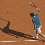 Roger Federer of Switzerland returns the ball to Novak Djokovic of Serbia during their semifinal match at the Monte Carlo Tennis Masters tournament in Monaco. (AP Photo/Michel Euler)<span class=
