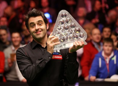 Geeza: Ronnie O'Sullivan celebrates with the trophy following his victory over Mark Selby during the 2014 Dafabet Masters at Alexandra Palace,