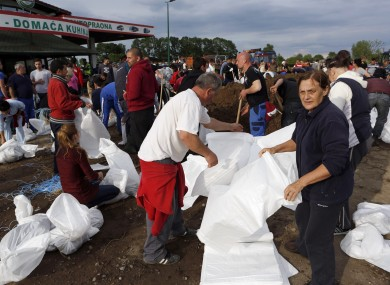 Bosnian people prepare sandbags to protect the city from flooding near Orasje 200 kms north of Sarajevo