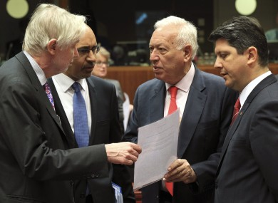 pain's Foreign Minister Jose Manuel Garcia-Margallo y Marfil, second right, talks with Finland's Foreign Minister Erkki Sakari Tuomioja, left, French Secretary of State for European Affairs Harlem Desir, second left, and Romania's Foreign Minister Titus Corlatean during an EU foreign ministers meeting at the European Council building in Brussels.