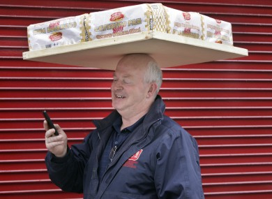 We don't know if Richard McKeon, who has worked for Johnston Mooney & O'Brien bakery since 1975, uses textspeak but we do admire his balancing act while delivering bread on Dublin's Baggot Street.