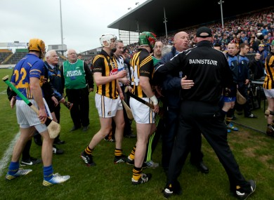 Brian Cody is restrained as the teams leave the field.