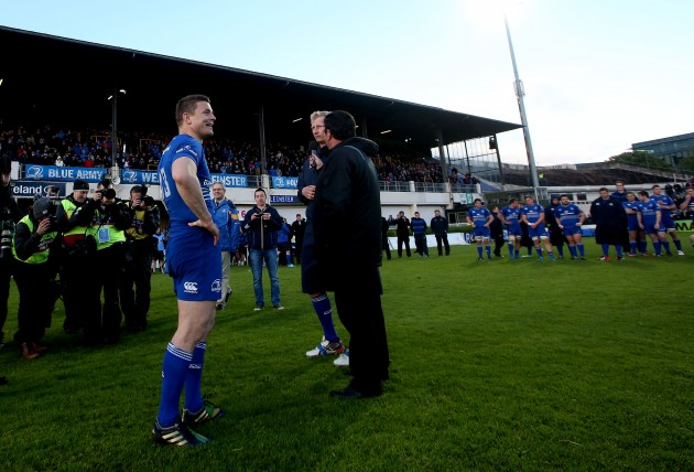 Brian O'Driscoll and Leo Cullen speak to the crowd after the game
