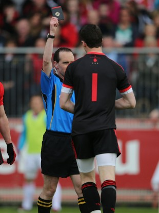 David Coldrick brandishes a black card to Niall Morgan on Sunday.