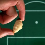 Micro-artist Quentin Devine's carved portrait of England football player Wayne Rooney using a Brazil nut. <span class=