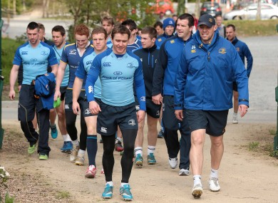 Eoin Reddan and coach Jono Gibbes lead the squad out for training.