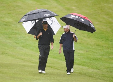 Ireland's Shane Lowry (right) with Denmark's Thomas Bjorn on the fairway during day three of the BMW PGA Championships at the Wentworth Club,
