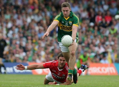 James O'Donoghue takes on Eoin Cadogan to shoot for a point.