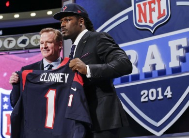 South Carolina defensive end Jadeveon Clowney holds up the jersey for the Houston Texans beside NFL's Roger Goddell.