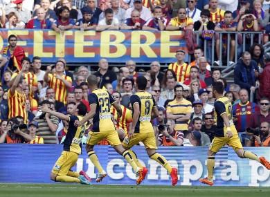 Atletico teammates celebrate after scoring.