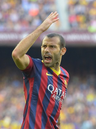 Barcelona's Javier Mascherano shows frustration during their game yesterday.