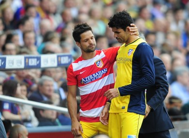 Costa comes off injured during the last game of the season against Barcelona.
