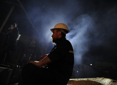 A Turkish miner at the entrance of the coal mine in Soma, Turkey