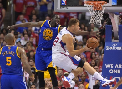 Clippers forward Blake Griffin, right, puts up a shot as Golden State Warriors forward Draymond Green defends.