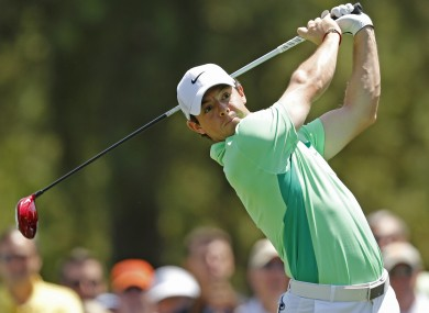 McIlroy watches his tee shot on the fourth hole during the second round of the Wells Fargo Championship.