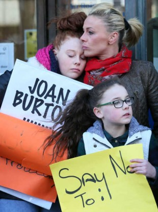 Gwen Connell with two of her three daughters Lauren (left, 17) and Katie (10) protest after being faced with homelessness due to a raising of their rent and a cut in rental allowance.
