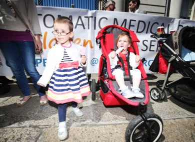 Sisters Aoife and Caoilann Keogh outside Government Buildings during Our Children's Health campaign protest