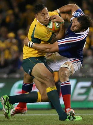Israel Folau takes the ball into contact against Damien Chouly in Melbourne.