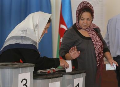 Azeri women cast their ballot papers at a polling station in Nardaran, 35km north of Baku, Azerbaijan last October.