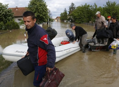 Bosnian people being rescued during the worst flooding the country had seen in a century (May 2014).