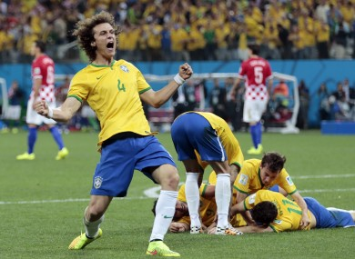 Luiz celebrates during Brazil's game with Croatia.