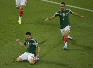 Mexico's Oribe Peralta celebrates after scoring during the group A World Cup soccer match.