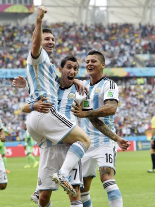 Messi, left, is carried by his teammates Argentina's Angel di Maria (7) and Marcos Rojo (16) after scoring his side's first goal.