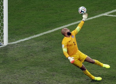 Tim Howard tips Eder's shot over the USA bar.