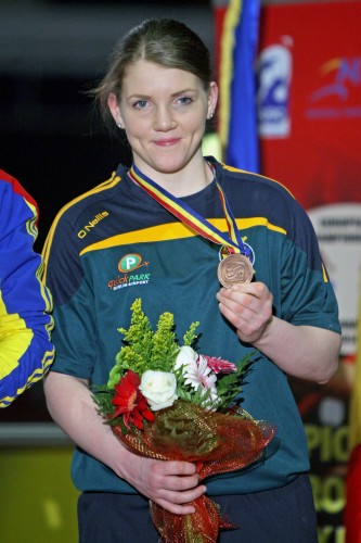 Clare Grace celebrates with her bronze medal