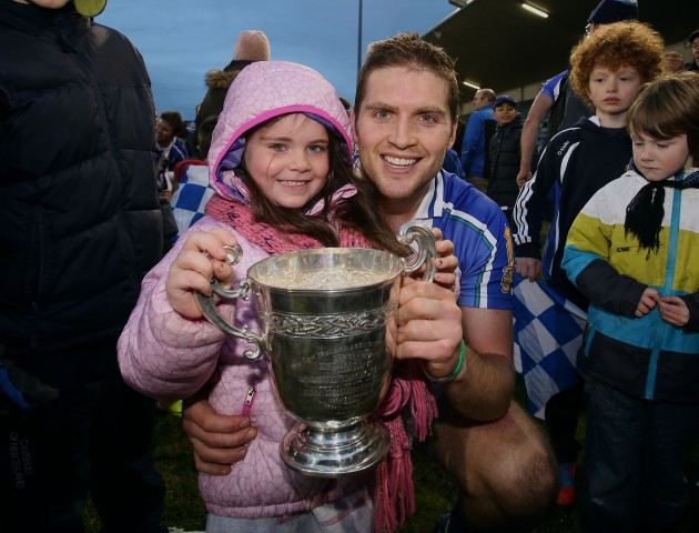 Conal Keaney celebrates winning with his daughter Kate