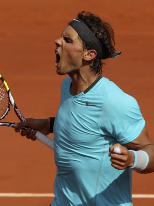 Rafael Nadal reacts as he wins the second set against Serbia's Novak Djokovic.