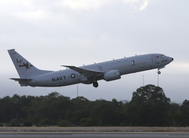 A US navy plane rejoins the search for MH370