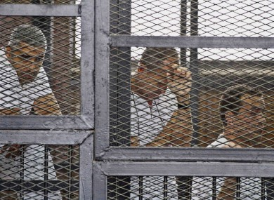From left, Mohammed Fahmy, acting bureau chief of Al-Jazeera, correspondent Peter Greste, and producer Baher Mohamed.