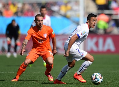 Chile's Alexis Sanchez (right) and Wesley Sneijder.
