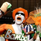 An Ivory Coast fan shows his support in the stands before kick off.<span class=