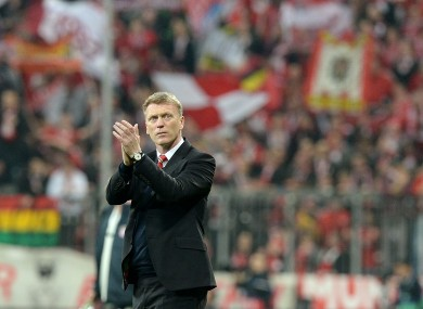 David Moyes applauds the Manchester United supporters after the club's Champions League elimination to Bayern Munich.